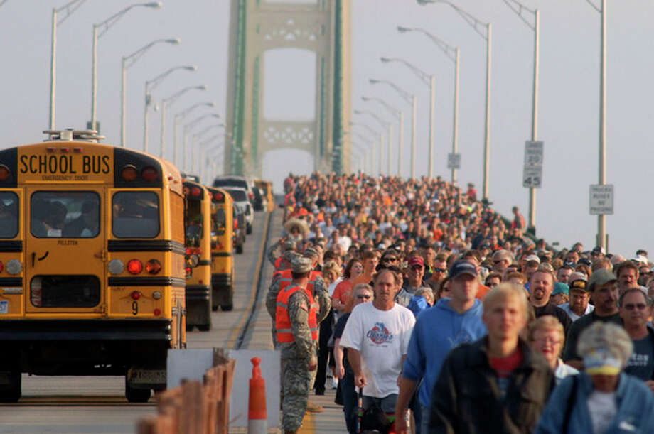 Thousands of people head south during the annual Labor Day Mackinac Bridge Walk, Monday, Sept. 3, 2012. Gov. Rick Snyder has led thousands of walkers and runners across the bridge for one of Michigan's most popular Labor Day traditions. (AP Photo/John L. Russell) / FR61762 AP