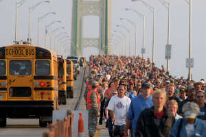 Thousands of people head south during the annual Labor Day Mackinac Bridge Walk, Monday, Sept. 3, 2012. Gov. Rick Snyder has led thousands of walkers and runners across the bridge for one of Michigan's most popular Labor Day traditions. (AP Photo/John L. Russell)
