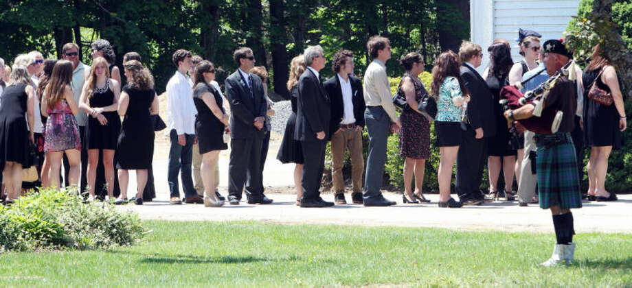 Family and friends arrive for a memorial service for Nancy Lanza Saturday June 1, 2013 in Kingston, N.H. LanzaÕs 20-year-old son, Adam Lanza, killed her at their home in Newtown, Conn., on Dec. 14 and then drove to Sandy Hook Elementary School, where he killed the children and six school employees before committing suicide. (AP Photo/Jim Cole)