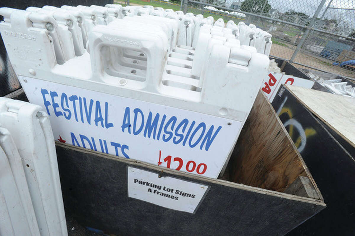 Hour photos/Matthew Vinci Above, final touches ready to set up on Monday at Veterans Park for the Oyster Festival. At right, cloudy skies over Veterans Park on Monday, the forecast calls for scattered showers over the next few days.