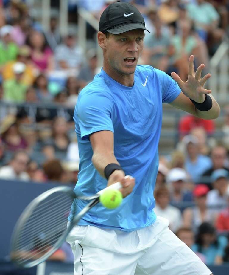 Czech Republic's Tomas Berdych returns a shot to Spain's Nicolas Almagro in the fourth round of play at the 2012 US Open tennis tournament, Monday, Sept. 3, 2012, in New York. Berdych won the match. (AP Photo/Henny Ray Abrams) / FR151332 AP