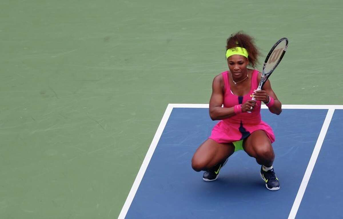 Serena Williams rreacts during her match against Czech Republic's Andrea Hlavackova in the fourth round of play at the 2012 US Open tennis tournament, Monday, Sept. 3, 2012, in New York. (AP Photo/Julio Cortez)