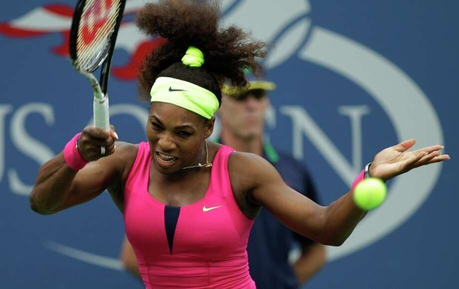 Serena Williams returns a shot to Czech Republic's Andrea Hlavackova in the fourth round of play at the 2012 US Open tennis tournament, Monday, Sept. 3, 2012, in New York. (AP Photo/Kathy Willens) / AP