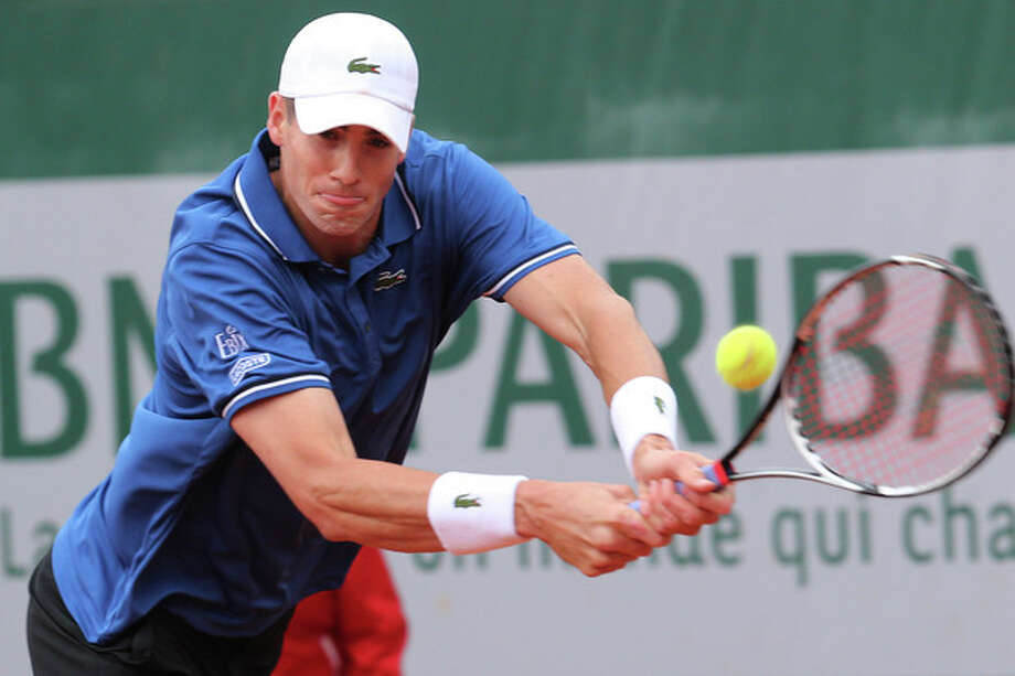 John Isner of the U.S. returns against compatriot Ryan Harrison in their second round match at the French Open tennis tournament, at Roland Garros stadium in Paris, Friday, May 31, 2013. (AP Photo/Michel Euler) / AP