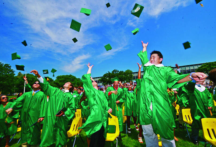 Trinity High School seniors celebrate during the Class of 2013 graduation ceremonies Saturday. Hour photo / Erik Trautmann