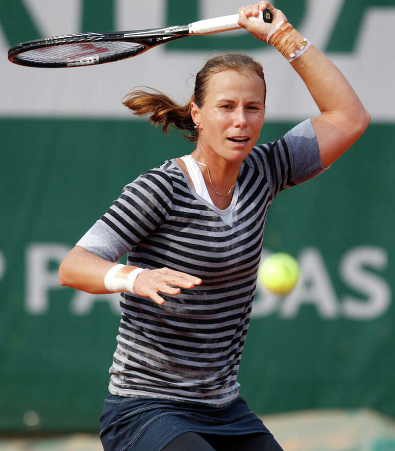 Varvara Lepchenko of the U.S. returns against Germany's Angelique Kerber in their third round match at the French Open tennis tournament, at Roland Garros stadium in Paris, Friday, May 31, 2013. (AP Photo/Christophe Ena) / AP