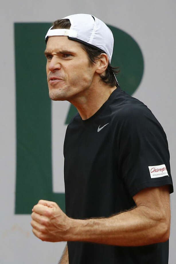Tommy Haas of Germany clenches his fist when scoring a point against Jack Sock of the U.S. in their second round match at the French Open tennis tournament, at Roland Garros stadium in Paris, Friday, May 31, 2013. Haas won in three sets 7-6, 6-2. 7-5. (AP Photo/Petr David Josek)