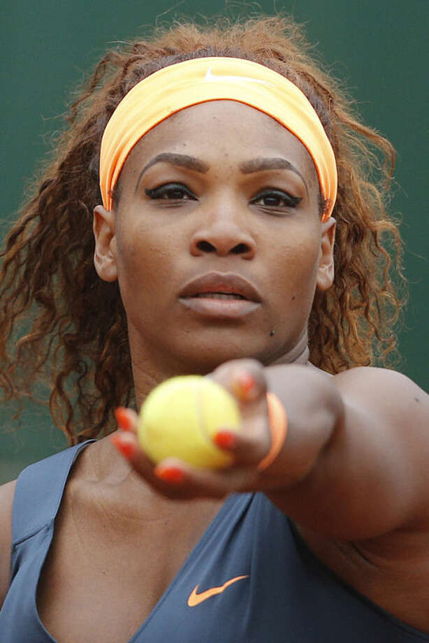 Serena Williams of the U.S. prepares to serve against Sorana Cirstea of Romania in their third round match at the French Open tennis tournament, at Roland Garros stadium in Paris, Friday, May 31, 2013. (AP Photo/Michel Spingler)