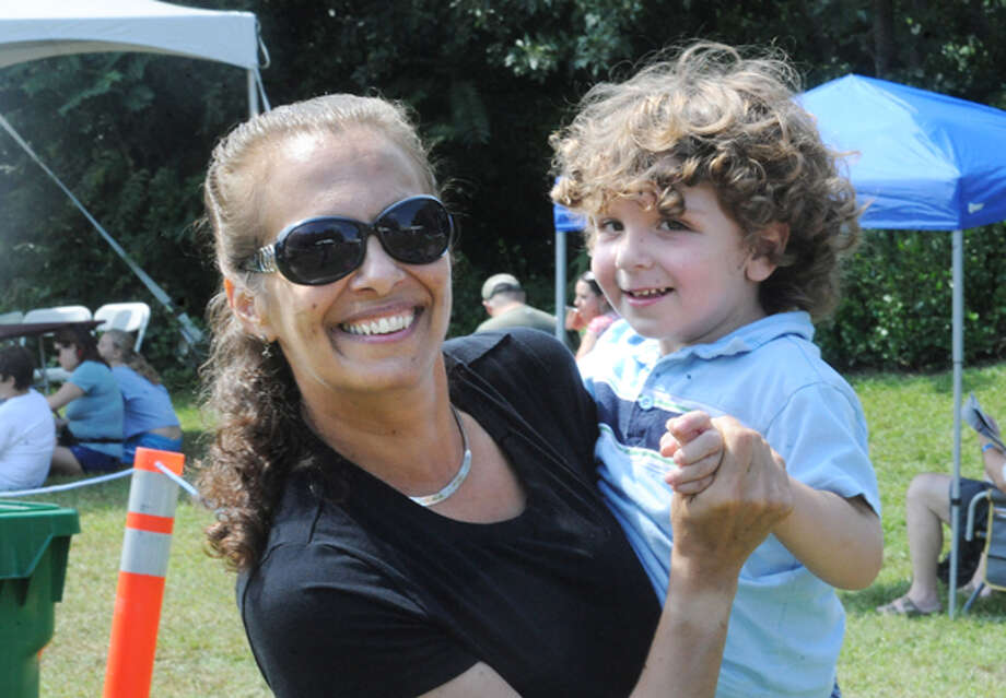 Pamela Reardon and her son Aaron 2, Sunday at the 5th annual Blues, Views & BBQ Festival in Westport. hour photo/Matthew Vinci