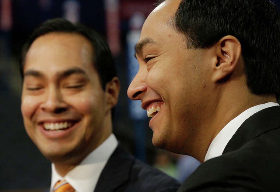 San Antonio Mayor Julian Castro, left, who will be the convention keynote speaker, and his twin brother, State Representative Joaquin Castro, who is running for U.S. Congress, are interviewed at the Democratic National Convention in Charlotte, N.C., Monday, Sept. 3, 2012. (AP Photo/Charles Dharapak) / AP
