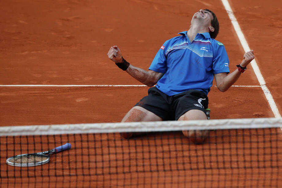 Tommy Robredo of Spain celebrates defeating Gael Monfils of France in their third round match at the French Open tennis tournament, at Roland Garros stadium in Paris, Friday, May 31, 2013. Robredo won in five sets 2-6, 6-7, 6-2, 7-6, 6-2. (AP Photo/Michel Spingler) / AP