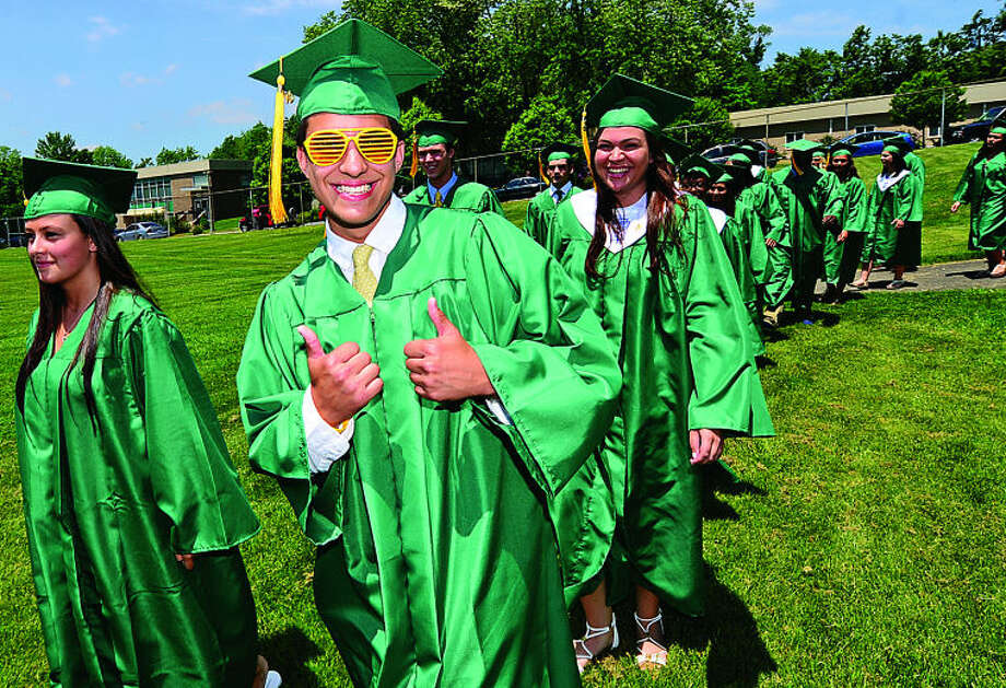 Trinity High School senior John Benalcazar celebrates during the Class of 2013 graduation ceremonies Saturday. Hour photo / Erik Trautmann