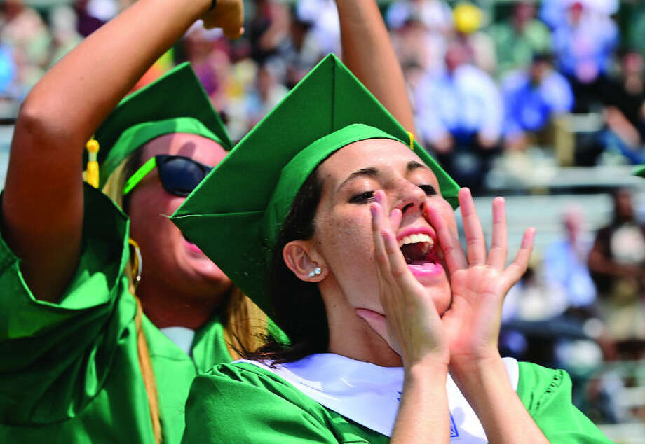 Trinity High School senior Alison Palma celebrates during the Class of 2013 graduation ceremonies Saturday. Hour photo / Erik Trautmann