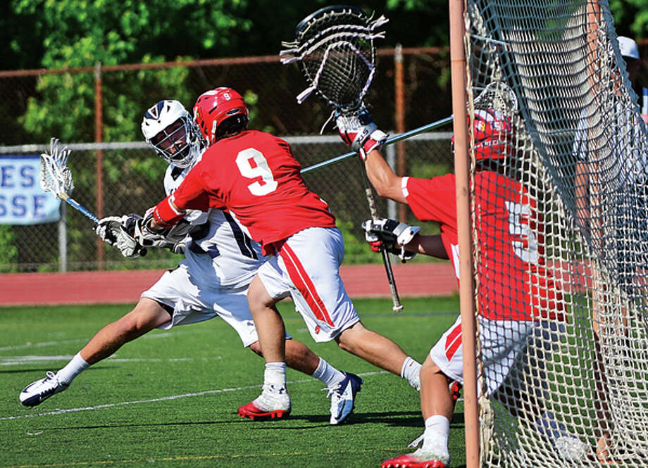 Staples #22 Joey Zelkowitz takes a shot on goal during their lacrosse game against Greenwich Saturday. Hour photo / Erik Trautmann / ©2012 Pascal Photographic Studios