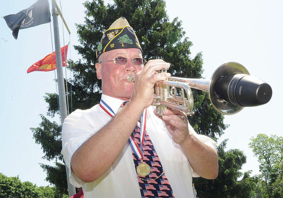 "Hour photo/Matthew VinciPast Commander Buddy Scudder plays ""To The Colors"" Sunday at the Veteran of the Month ceremony in honor of Norwalk native and WW II vetertan William M. Flynn at the American Legion. / (C)2011 {your name}, all rights reserved"