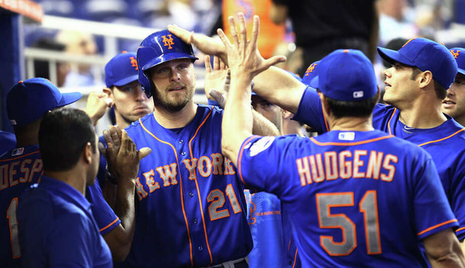 New York Mets' Lucas Duda (21) celebrates in the dugout after he hit a solo homer during the second inning of the MLB National League baseball game against the Miami Marlins in Miami Sunday, June 2, 2013. (AP Photo/J Pat Carter) / AP