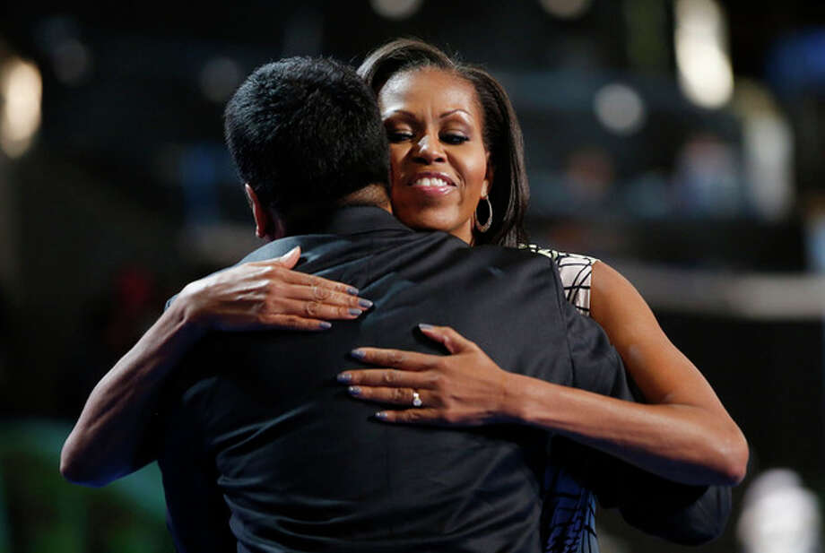 First Lady Michelle Obama hugs actor Kal Penn after filming a campaign video at the Democratic National Convention inside Time Warner Cable Arena in Charlotte, N.C., on Monday, Sept. 3, 2012. (AP Photo/Jae C. Hong) / AP