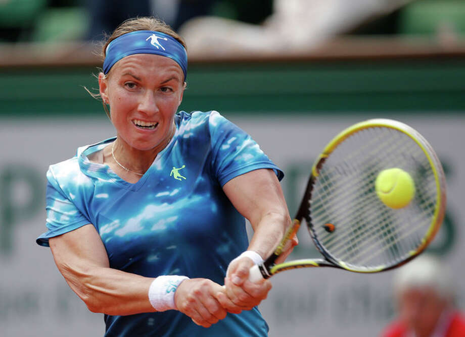 Svetlana Kuznetsova, of Russia, returns the ball to Germany's Angelique Kerber during their fourth round match of the French Open tennis tournament at the Roland Garros stadium Sunday, June 2, 2013 in Paris. (AP Photo/Christophe Ena) / AP