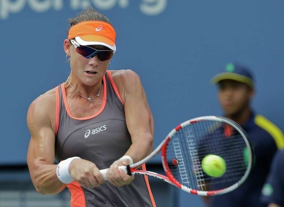 Samantha Stosur, of Australia, returns a shot to Victoria Azarenka, of Belarus, in the quarterfinals of the 2012 US Open tennis tournament, Tuesday, Sept. 4, 2012, in New York. (AP Photo/Mike Groll) / AP