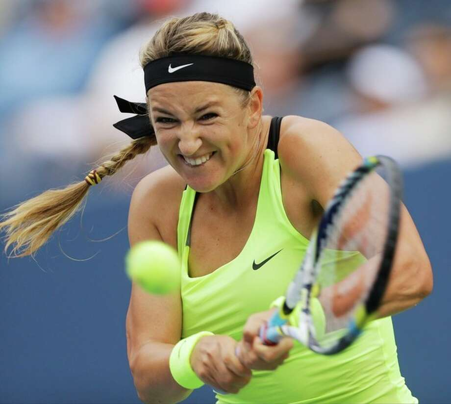 Victoria Azarenka, of Belarus, returns a shot to Samantha Stosur, of Australia, in the quarterfinals of the 2012 US Open tennis tournament, Tuesday, Sept. 4, 2012, in New York. (AP Photo/Mike Groll) / AP