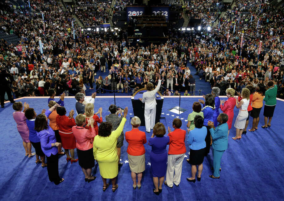 House Minority Leader Nancy Pelosi waves to delegates with women from the House of Representatives at the Democratic National Convention in Charlotte, N.C., on Tuesday, Sept. 4, 2012. (AP Photo/Charlie Neibergall) / AP