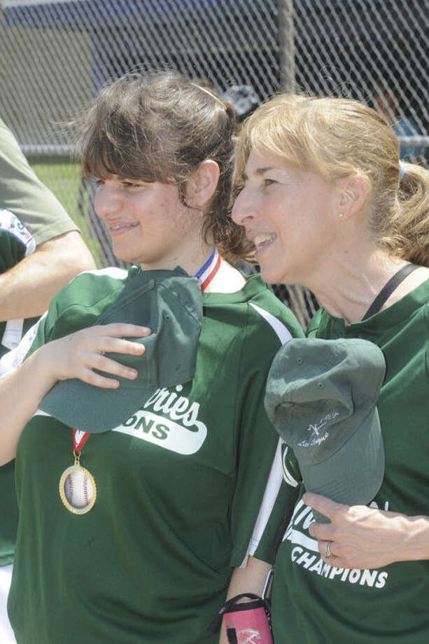 Coach Dawn Dinoto with her daughter Anisa who participated in the Norwalk little league challenger recognition day for athletes with special needs on Sunday in Norwalk. Hour photo/Matthew Vinci