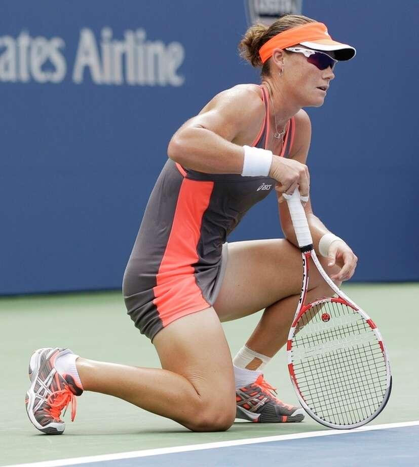 Samantha Stosur, of Australia, reacts after losing her match to Victoria Azarenka, of Belarus, in the quarterfinals of the 2012 US Open tennis tournament, Tuesday, Sept. 4, 2012, in New York. (AP Photo/Kathy Willens) / AP