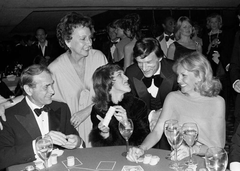 Actress Jean Stapleton, top left, and publisher Hugh Hefner laugh with, from foreground left, Darren McGavin, Ruth Buzzi and Barbara Fisher, during a black-tie casino fund raiser in Los Angeles on Monday, March 13, 1979. Stapleton has died at the age of 90. John Putch said Saturday, June 1, 2013 that his mother died Friday, May 31, 2013 of natural causes at her New York City home surrounded by friends and family. (AP Photo/Lennox McLendon) / AP