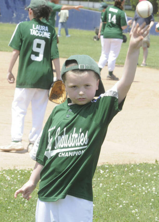 Hour photo/Matthew VinciJacob Wilson participated in the Norwalk Little League Challenger Recognition Day for athletes with special needs on Sunday in Norwalk.