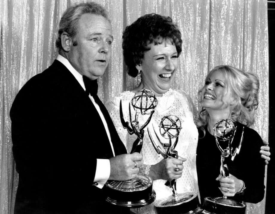 "FILE - Cast members of ""All in the Family,"" from left, Carroll O'Connor, Jean Stapleton, and Sally Struthers pose with their Emmys backstage at the 24th annual Emmy Awards in Hollywood, Ca., Sunday night, May 14, 1972. O'Connor and Stapleton won outstanding continued performance by an actor and actress in a leading role in a comedy series. Struthers tied in the category of outstanding performance by an actress in a supporting role in a comedy. Stapleton has died at the age of 90. John Putch said Saturday, June 1, 2013 that his mother died Friday, May 31, 2013 of natural causes at her New York City home surrounded by friends and family. (AP Photo) / AP"