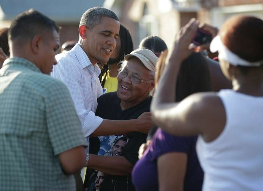 President Barack Obama greets local residents as he tours the Bridgewood neighborhood in LaPlace, La., in the Saint John the Baptist Parish for the ongoing response and recovery efforts to Hurricane Isaac, Monday, Sept. 3, 2012. (AP Photo/Pablo Martinez Monsivais) / AP