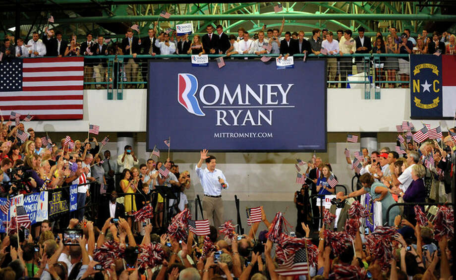 Republican vice presidential candidate, Rep. Paul Ryan, R-Wis., is welcomed after entering a campaign event at East Carolina University, Monday, Sept. 3, 2012, in Greenville, N.C. (AP Photo/Sara D. Davis) / FR73479 AP