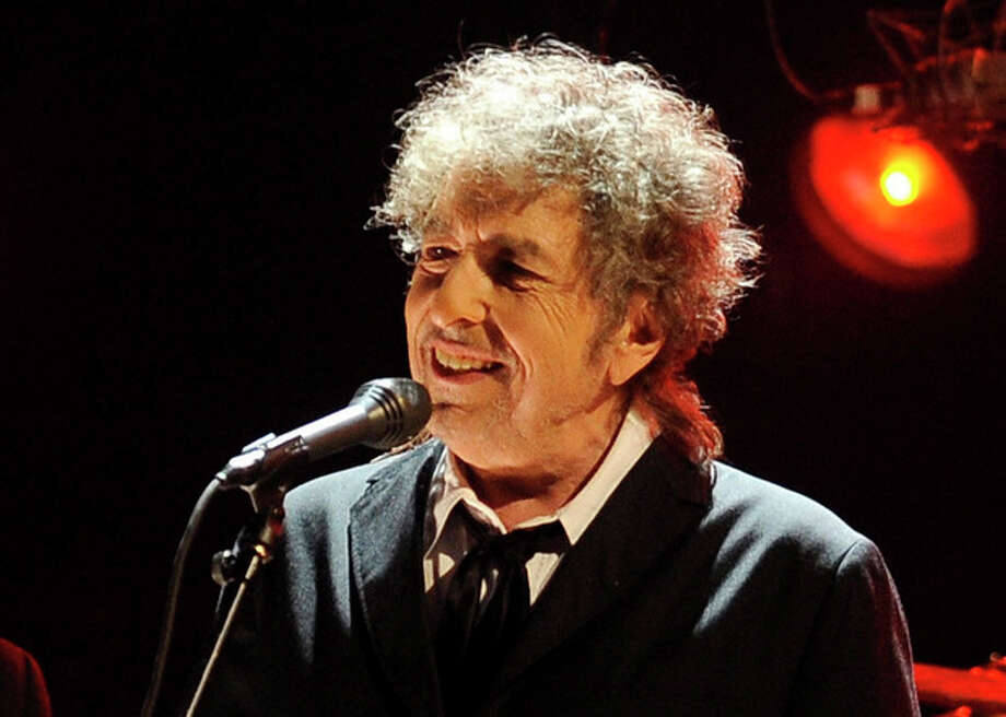 FILE - In this Jan. 12, 2012 file photo, Bob Dylan performs in Los Angeles. Fifty years into his career as a recording artist and a week away from release of an extraordinary new CD, Dylan spent his Tuesday evening where he seems to feel most comfortable — on a stage. (AP Photo/Chris Pizzello, File) / AP