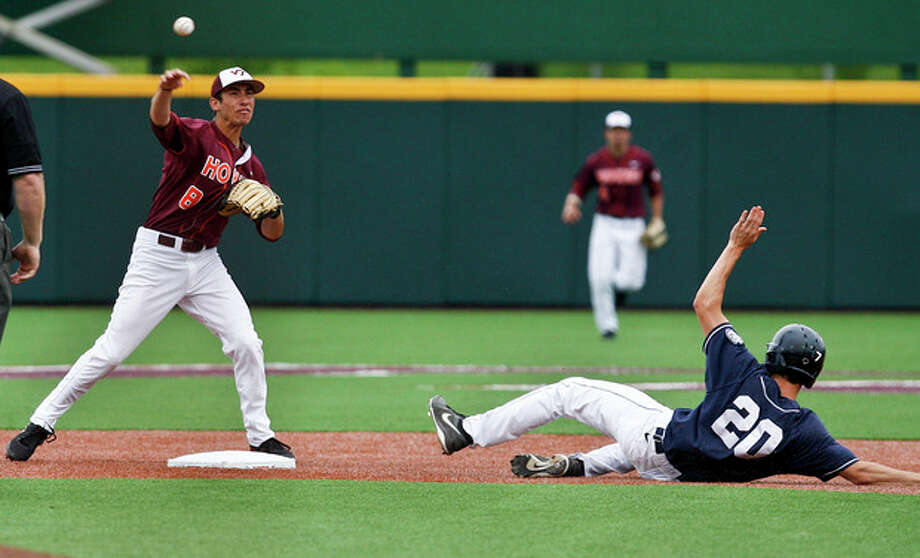 Virginia Tech's Alex Perez, left, steps on second to put out Connecticut's Ryan Moore (20) and fires to first to complete a double play during the ninth inning of an NCAA college baseball tournament regional game at English Field in Blacksburg, Va., Sunday, June 2, 2013. (AP Photo/Michael Shroyer) / FR 170944 AP