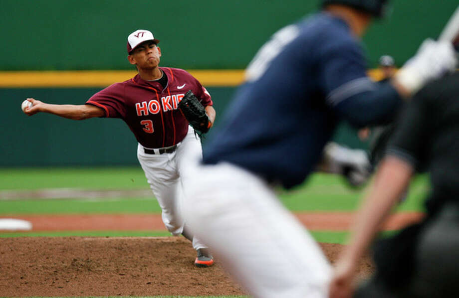 Virginia Tech's Clark Labitan pitches during the ninth inning of an NCAA college baseball tournament regional game against Connecticut at English Field in Blacksburg, Va., Sunday, June 2, 2013. (AP Photo/Michael Shroyer) / FR 170944 AP