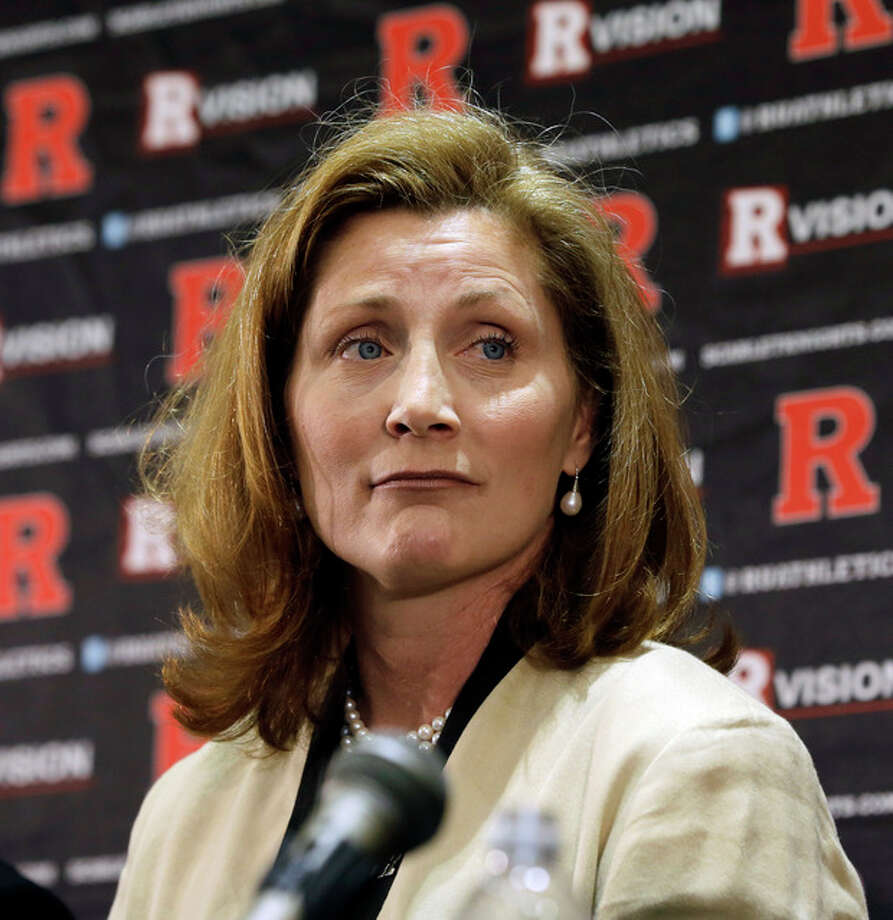 FILE - In this Wednesday, May 15, 2013 file photo, Julie Hermann listens during a news conference where she was introduced as the new athletic director at Rutgers University, in Piscataway, N.J. Hermann, hired to clean up Rutgers' scandal-scarred athletic program, quit as Tennessee's women's volleyball coach 16 years ago after her players submitted a letter complaining she ruled through humiliation, fear and emotional abuse, The Star-Ledger reported Saturday, May 25, 2013, on its website. (AP Photo/Mel Evans, File) / AP