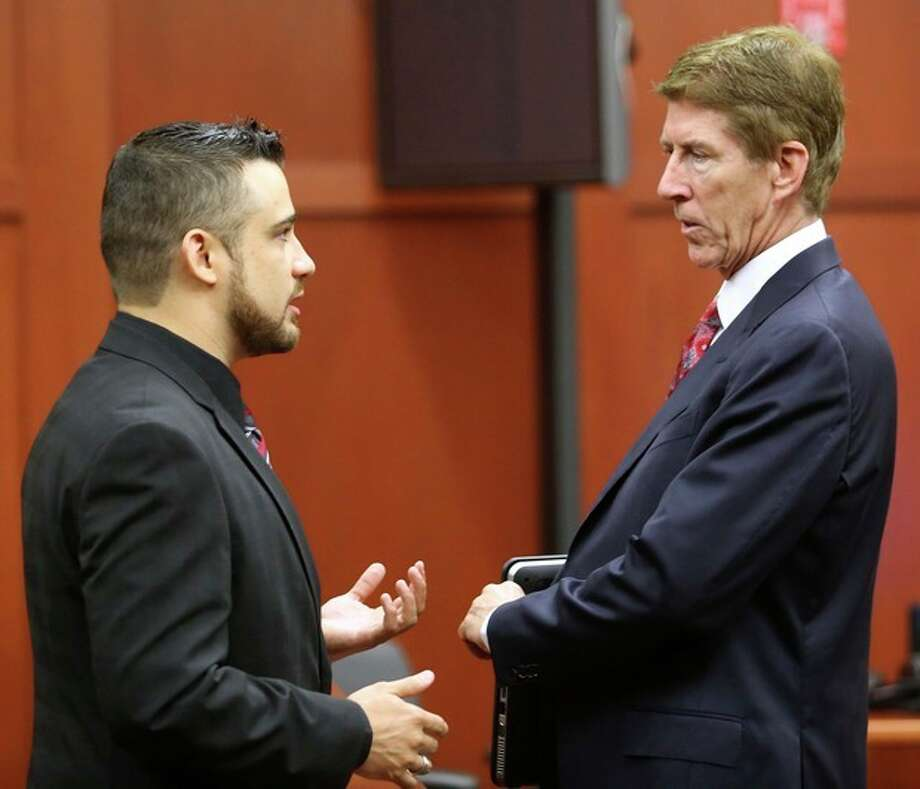 Robert Zimmerman Jr., left, the brother of George Zimmerman, the accused shooter of Trayvon Martin, talks with defense attorney Mark O'Mara, during a pre-trial hearing, Tuesday, May 28, 2013 in Sanford, Fla. George Zimmerman has been charged with second-degree murder for the 2012 shooting death of Trayvon Martin. He was not in court for the hearing. (AP Photo/Orlando Sentinel, Joe Burbank, Pool) / POOL, Orlando Sentinel