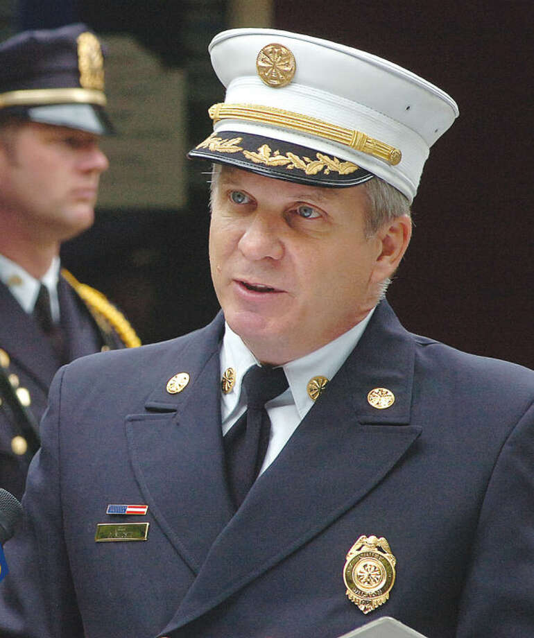 File Photo/Alex von Kleydorff. Wilton Fire Chief Paul Milositz speaks to the crowd at the town's September 11th Rememberance held at Fire headquaters on Thursday.