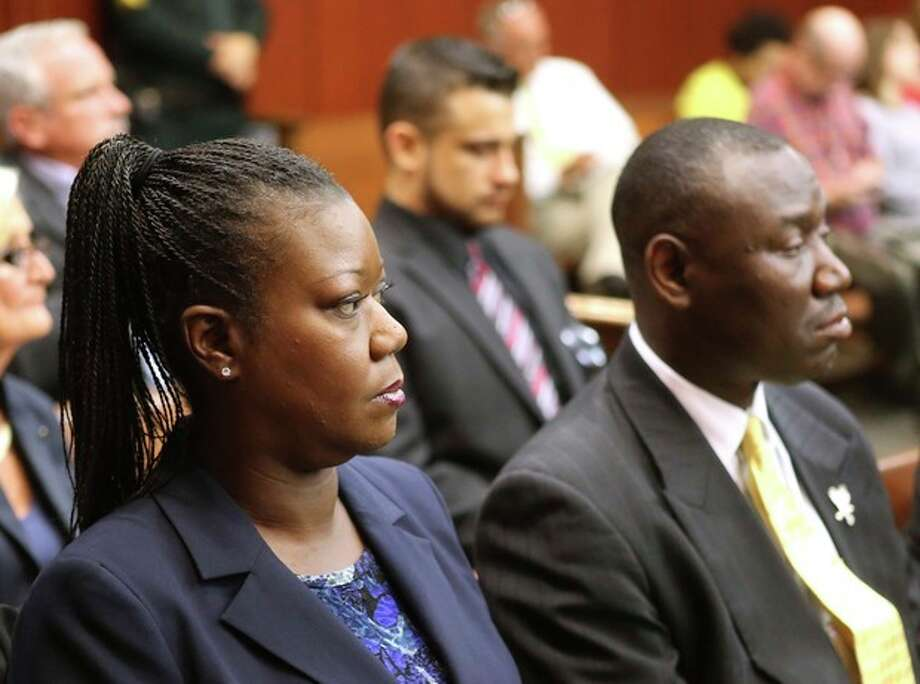 Sybrina Fulton, the mother shooting victim Trayvon Martin, sits with with her attorney Benjamin Crump, during a pre-trial hearing for George Zimmerman, the accused shooter of Trayvon Martin, Tuesday, May 28, 2013 in Sanford, Fla. Zimmerman has been charged with second-degree murder for the 2012 shooting death of Trayvon Martin. He was not in court for the hearing. (AP Photo/Orlando Sentinel, Joe Burbank, Pool) / POOL, Orlando Sentinel