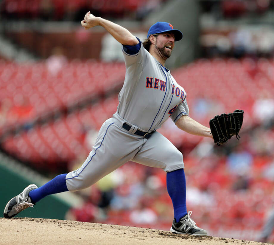 New York Mets starting pitcher R.A. Dickey throws during the second inning of a baseball game against the St. Louis Cardinals Wednesday, Sept. 5, 2012, in St. Louis. (AP Photo/Jeff Roberson) / AP