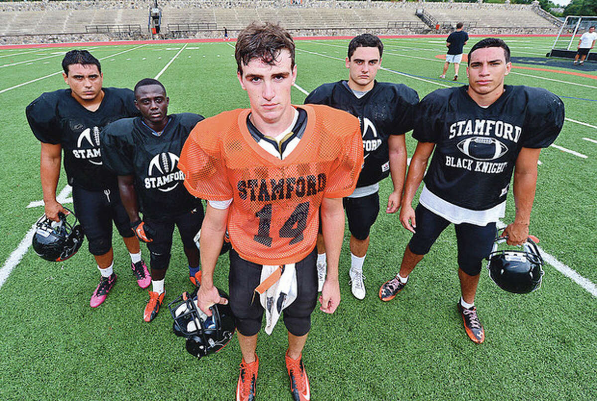 Photo by Erik Trautmann Stamford High football captains, from left, are Rodrigo DeNapoli, Jerry Aime, Tyler Kane, Frank Calandro, and Miguel Nieto. The Black Knights are hoping for another season as successful as last year's 7-2 campaign.