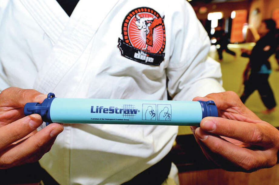 Manny Esmeraldo trains students at The DoJo in Stamford Tuesday. The Dojo is sponsoringa walk /run to benefit Lifestraw.