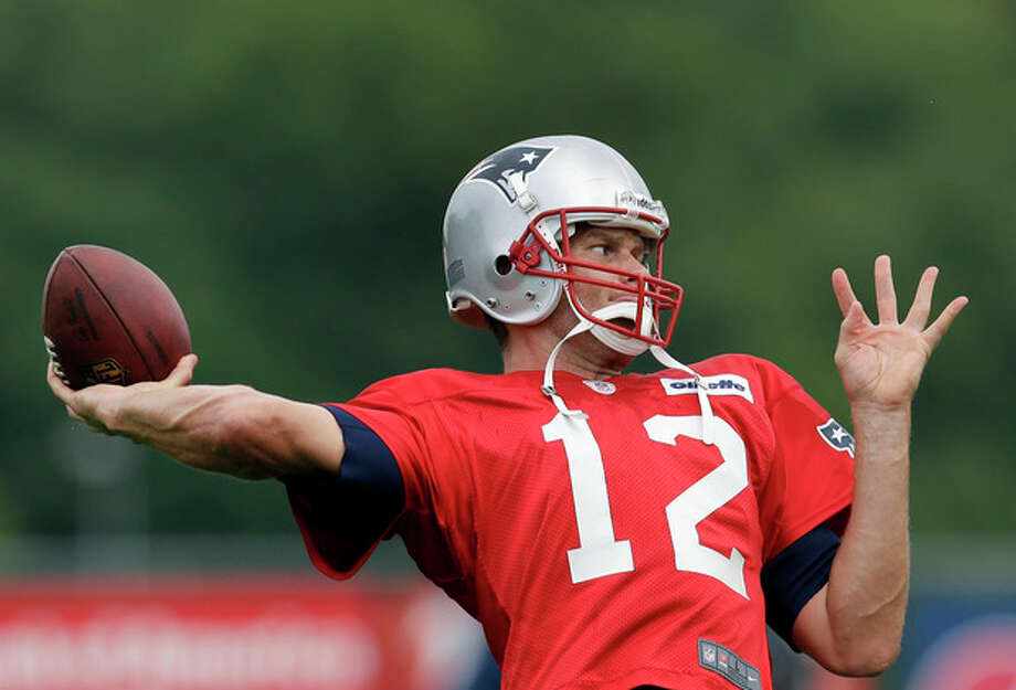 New England Patriots quarterback Tom Brady throws during practice at Gillette Stadium in Foxborough, Mass. Wednesday, Sept. 5, 2012. The Patriots are preparing for their NFL football season opener against the Tennessee Titans on Sunday. (AP Photo/Elise Amendola) / AP