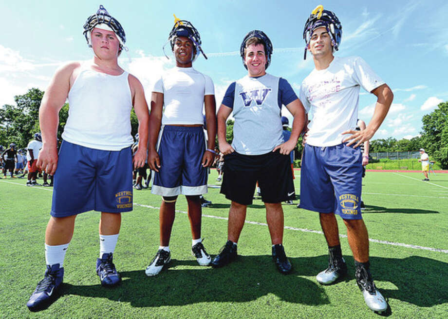 Photo by Erik TrautmannWesthill High Schol football captains, from left, Chris Soule, Yveson Cassamajor, Mike Vigilotti and Nick Jimenez are looking to turn around a program that has lost 19 games in a row. / ©2012 The Hour Newspapers