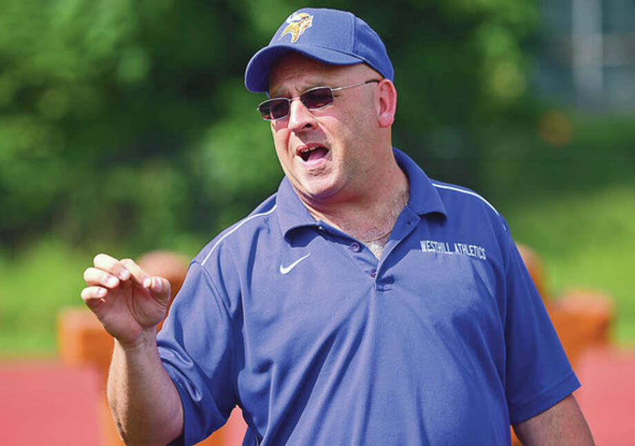 Photo by Erik TrautmannWesthill High Schol football coach Frank Marcucio has brought renewed hope to a struggling program that has lost 19 straight games. / ©2012 The Hour Newspapers