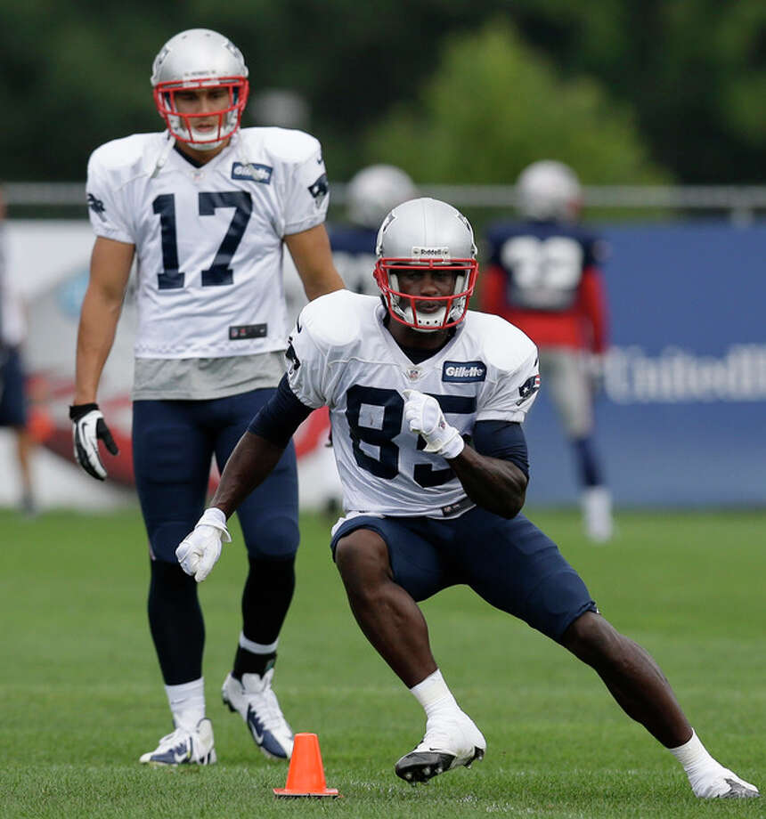 New England Patriots wide receiver Brandon Lloyd (85) cuts as wide receiver Greg Salas (17) watches during a practice drill at Gillette Stadium in Foxborough, Mass. Wednesday, Sept. 5, 2012. The Patriots are preparing for their NFL football season opener against the Tennessee Titans on Sunday. (AP Photo/Elise Amendola) / AP