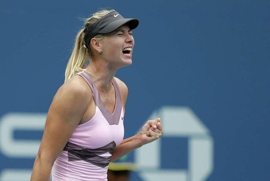 Russia's Maria Sharapova celebrates during her match with Marion Bartoli, of France, in the quarterfinals during the 2012 US Open tennis tournament, Wednesday, Sept. 5, 2012, in New York. (AP Photo/Darron Cummings) / AP