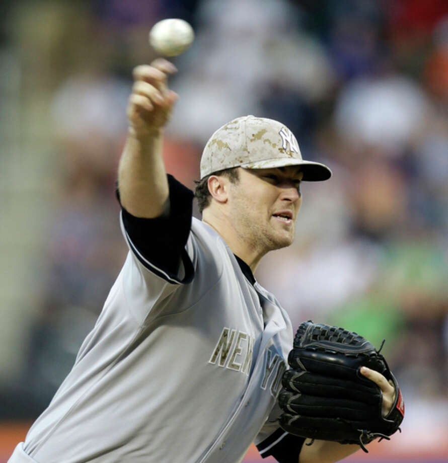 New York Yankees starting pitcher Phil Hughes delivers in the first inning of an interleague baseball game at Citi Field in New York, Monday, May 27, 2013. (AP Photo/Kathy Willens) / AP