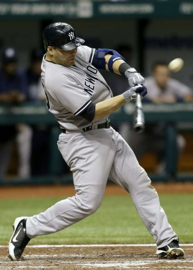 New York Yankees' Russell Martin lines a fourth-inning, two-run double off Tampa Bay Rays starting pitcher Matt Moore during a baseball game, Wednesday, Sept. 5, 2012, in St. Petersburg, Fla. Yankees' Robinson Cano and Alex Rodriguez scored on the play. (AP Photo/Chris O'Meara)