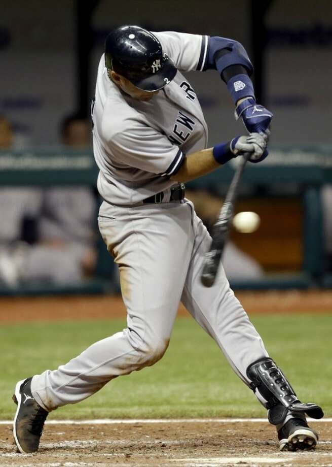 New York Yankees' Derek Jeter hits a seventh-inning fielder's choice off Tampa Bay Rays relief pitcher Kyle Farnsworth during a baseball game, Wednesday, Sept. 5, 2012, in St. Petersburg, Fla. Two runs scored on a throwing error by Rays' Elliot Johnson. (AP Photo/Chris O'Meara)